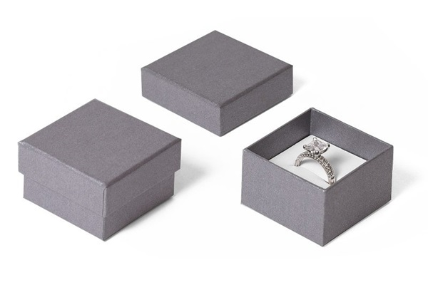 grey paper ring box with white leatherette interior.