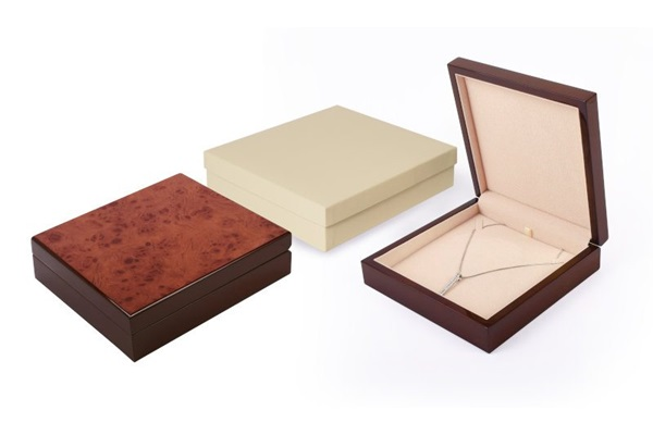 burl wood necklace box with cram interior and cream outer box.