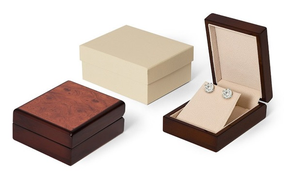 burl wood earring box with cram interior and cream outer box.