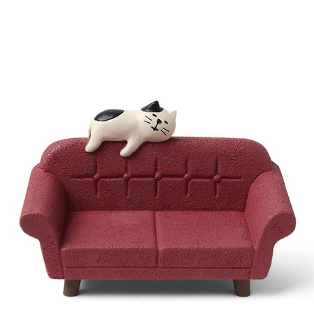 Figurine Cat on Red Sofa