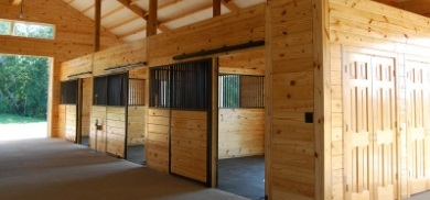 Sliding horse stalls with wood fill