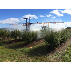 CCI 400 gallon hoop boom sprayer in field