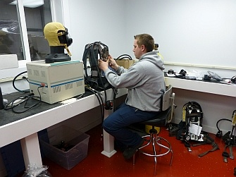 A Shipman's employee performing a functional flow test on a Scott Air-Pak